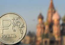 Ruble drops to 2015 low amid oil price slump